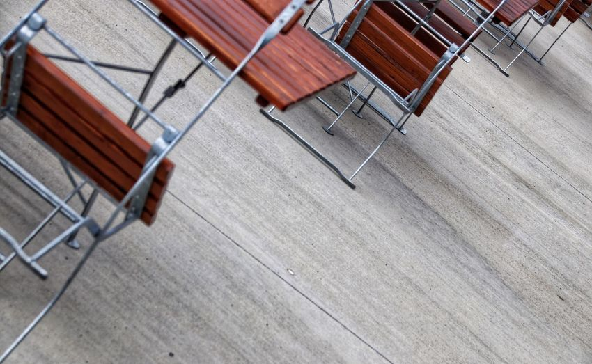 High angle view of empty chairs on wooden floor
