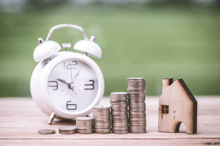 Finance Coin Clock Business Savings Time Focus On Foreground Wealth Selective Focus Close-up Alarm Clock Still Life Metal Investment Currency No People Number Stack Wood - Material Finance And Economy Economy Clock Face Silver Colored