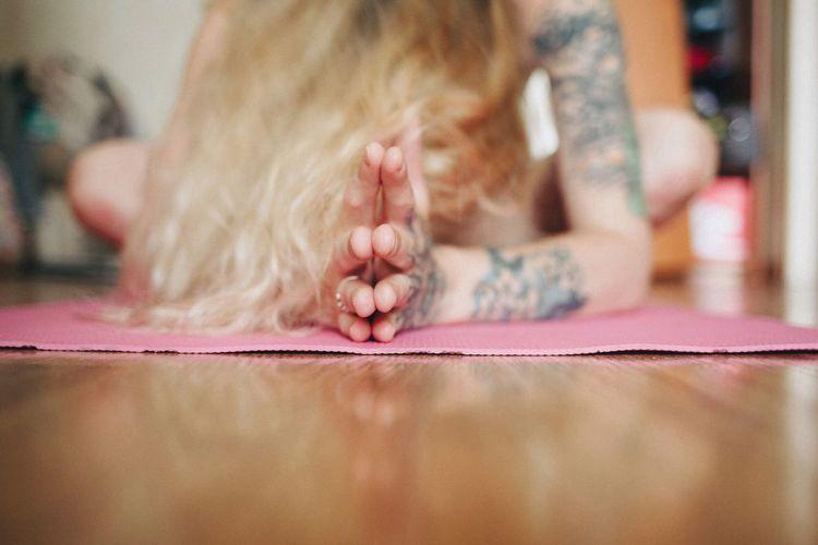Teenage girl practicing yoga at home