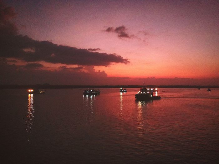 sunset behind the boat Sunset Tug Boat Evening View Sea