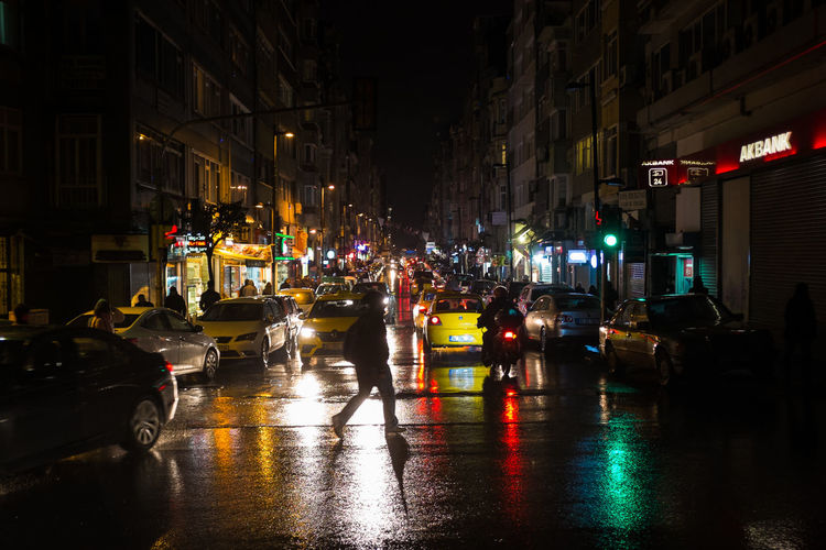 Rainy Istanbul nights. Architecture Building Exterior Built Structure Busy Street Car Cars City City Street Illuminated Istanbul Night Night Lights Nightlife Osmanbey Outdoors Rainy Night Reflections Street Streetphotography Taxi Traffic Traffic Lights Transportation Urbanphotography Wet