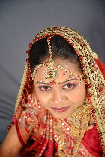 wedding photoshoot Indian Marriage Marriage  Marriage Ceremony Marriage Photoshoot Marriage Photography Beatiful Girl Dulhan Photography Themes Studio Photography Marriedlyfe Bride Period Costume Portrait Young Women Beautiful Woman Beauty Smiling Looking At Camera Studio Shot Headshot Sari Indian Culture  Red Lipstick Bangle Lipstick Jewelry Earring  Wedding Dress Wedding Ceremony Henna Tattoo Groom