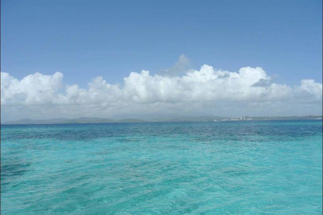 Sea Blue Cloud - Sky Sky Nature Beach Tropical Climate Scenics Tranquility Outdoors Day Beauty In Nature No People Water Vacations Horizon Over Water Tree Travel Destinations Landscape Beauty Waterfront City Beachphotography Waterphoto Photography
