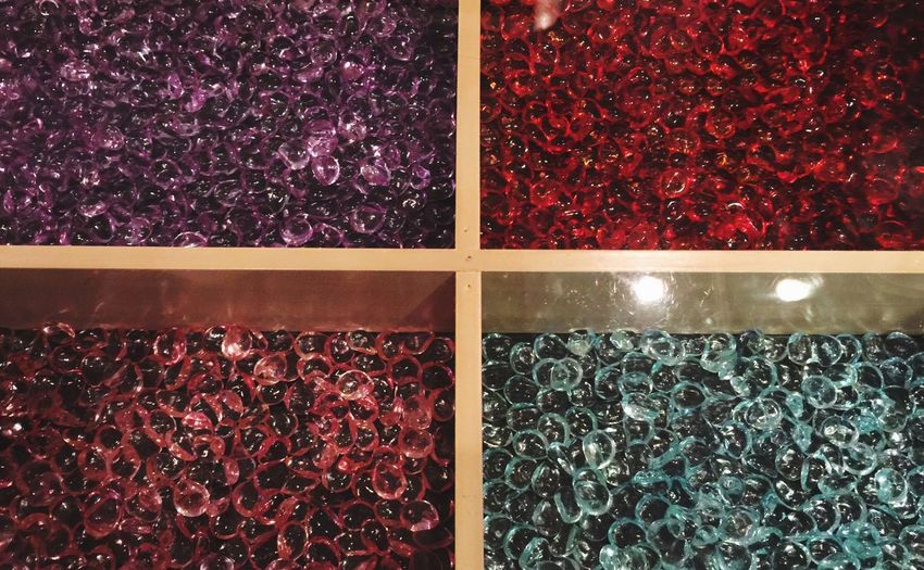 Multi-colored tiny stones in a table display