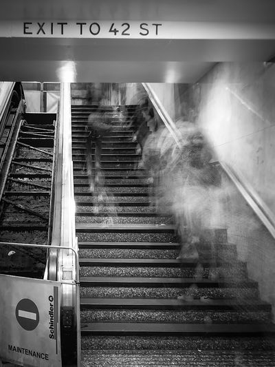 Blurred motion of people at subway station