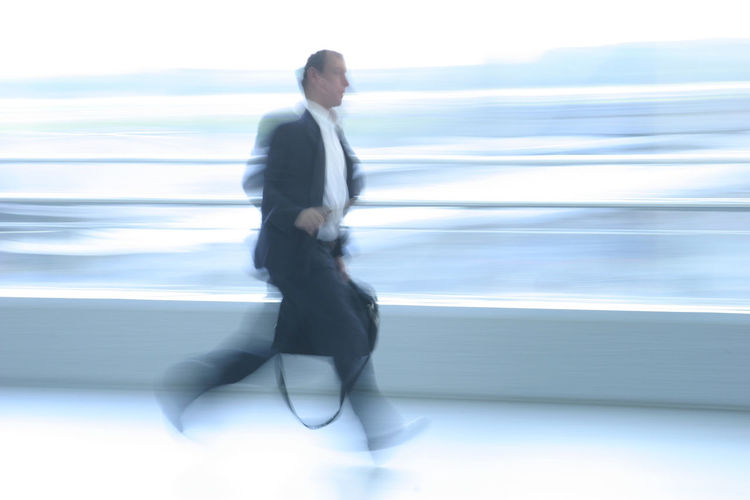 Business man in a hurry Adult Adults Only Blurred Motion Business Businessman Corporate Business Day Full Length Full Suit In A Hurry  Men Motion One Man Only One Person Only Men People Running Speed Well-dressed