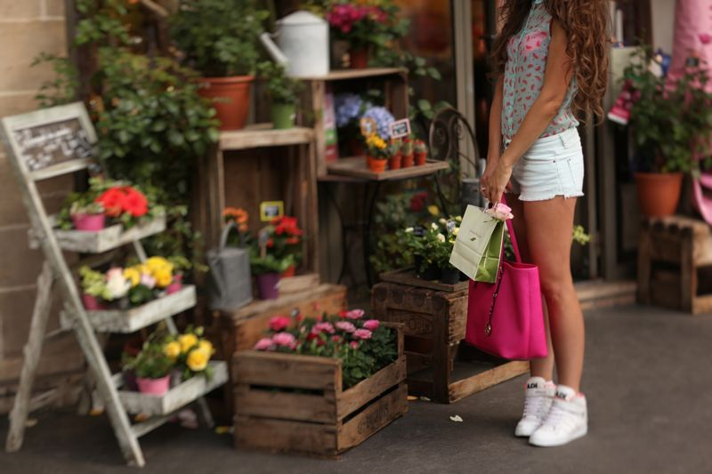 Low Section Of Young Woman Buying Potted Plants