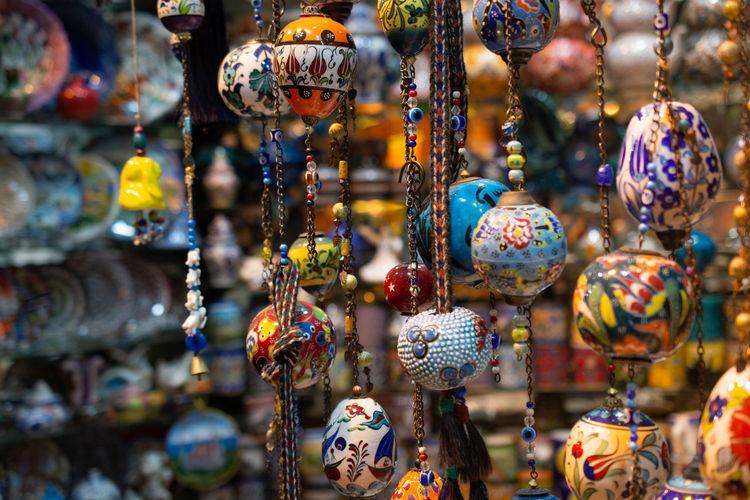 Full frame shot of souvenir hanging for sale in market