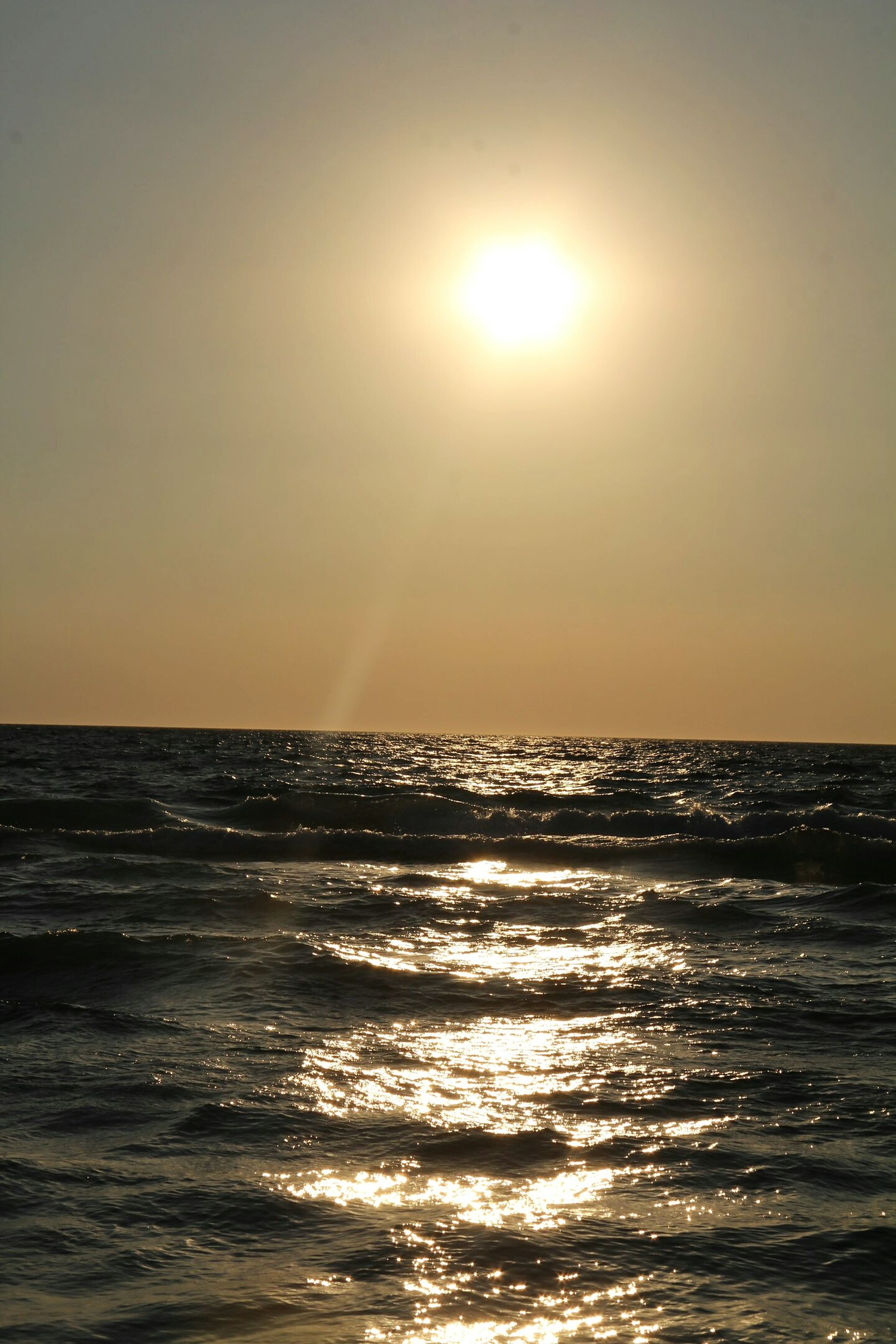 sea, sunset, sun, horizon over water, scenics, beauty in nature, sunlight, nature, tranquility, sky, tranquil scene, water, no people, outdoors, wave, beach, day