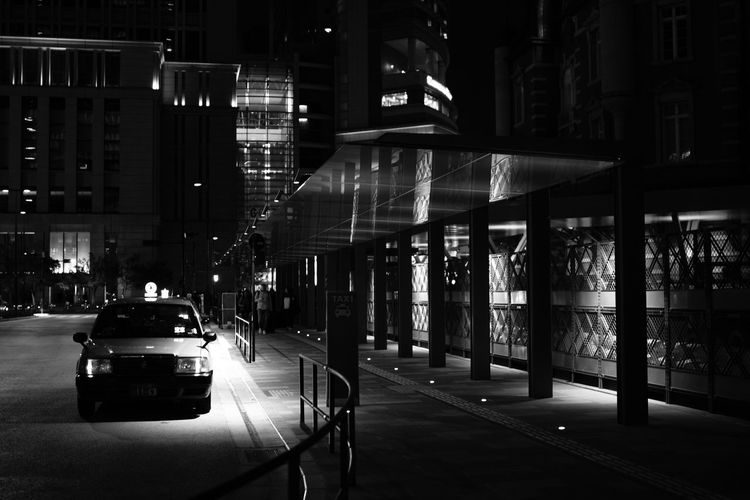Architecture Car Night Building Exterior Transportation Built Structure Land Vehicle Street City Illuminated Mode Of Transport Outdoors Road No People EyeEm Best Shots Taxi Tokyo Tokyostation Monochrome Blackandwhite