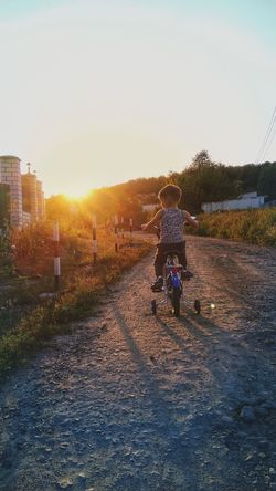 Adult Full Length People Adults Only Sunset Sunlight Outdoors Sky Real People Young Adult Bicycle Little Boy Light Walking Son Evening Workout Lifestyles Warm