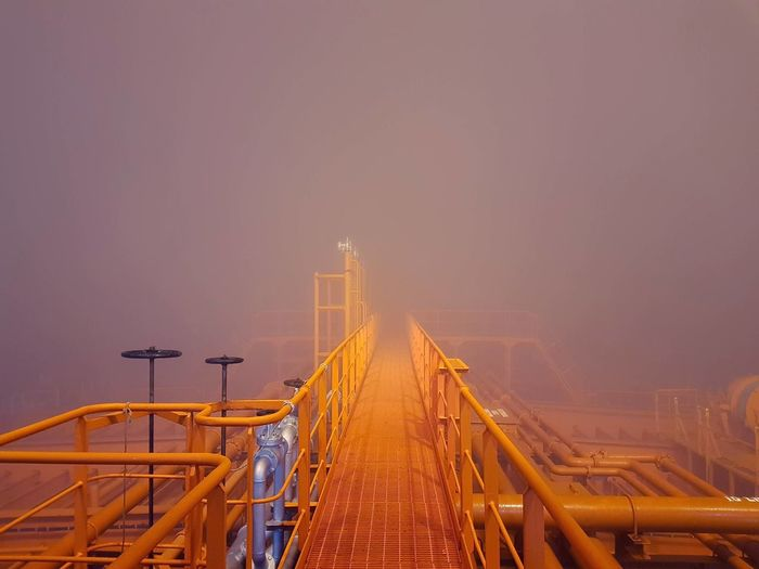 Metallic bridge in foggy weather