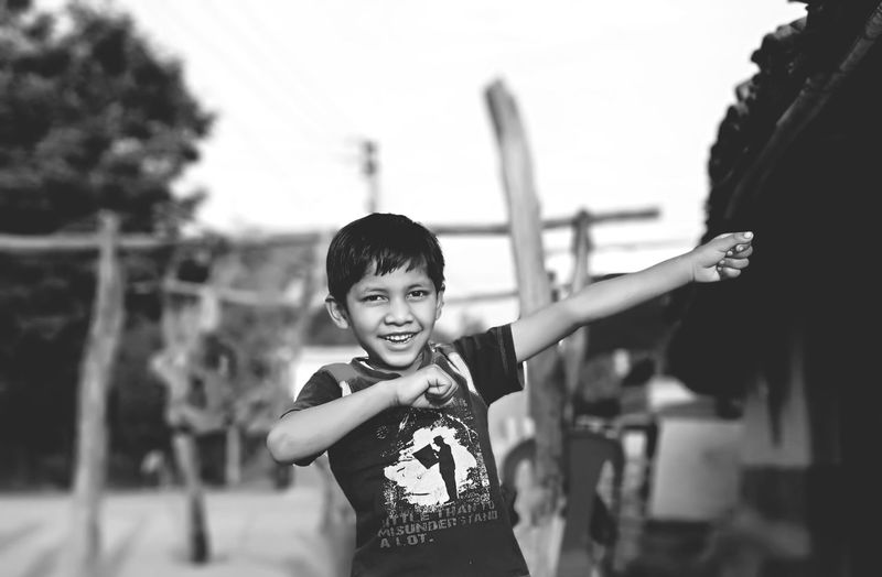 EyeEm Selects Blackandwhite Boy Rural Village Friendship Portrait Child Childhood Smiling Boys Looking At Camera Happiness Playing Males