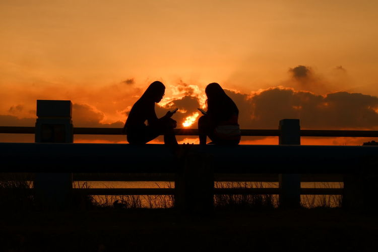 Sunset Silhouette Two People Love Couple - Relationship Togetherness People Sky Outdoors Water Nature Women