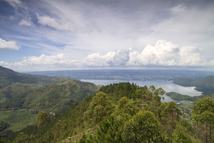 Scenics view from a top of mountain with an amazing clouds and mountains range. INDONESIA Nature Beauty In Nature Cloud - Sky Day Environment Land Landscape Mountain Mountain Range Nature No People Non-urban Scene Ocean Outdoors Plant Scenics Scenics - Nature Sea Seascape Sky Tranquil Scene Tranquility Tree Water