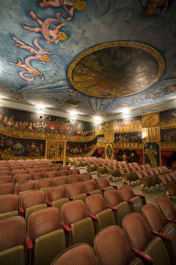 Old opera house Absence Architecture Arrangement Arts Culture And Entertainment Auditorium Built Structure Chair Empty Illuminated In A Row Indoors  Large Group Of Objects Lighting Equipment Luxury Movie Theater No People Order Place Of Worship Seat Side By Side Stage Stage Theater