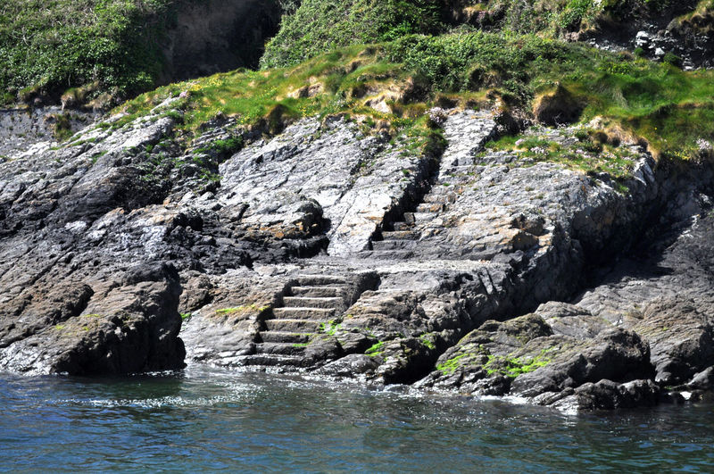 Steps carved into side of hill by Irish monks Carved Stones Ireland Landscapes Irish Landscape Beauty In Nature Mountain Steps Natural Doi Nature No People Rock - Object Steps In Nature Tranquility Water Waterfront