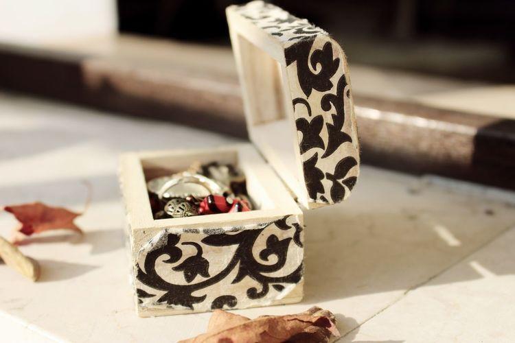 Jewelry in box on floor