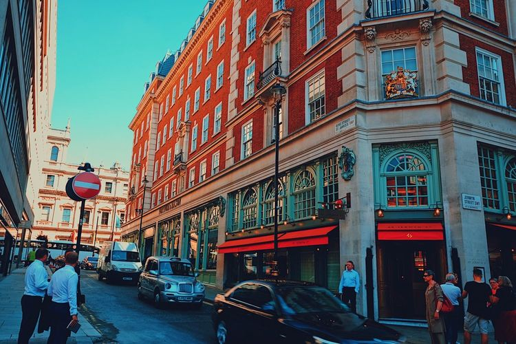 Mayfair morning traffic, London. Architecture Building Exterior Built Structure Car City City Life Clear Sky Day Land Vehicle Men Mode Of Transport Outdoors People Real People Road Sky Street Transportation