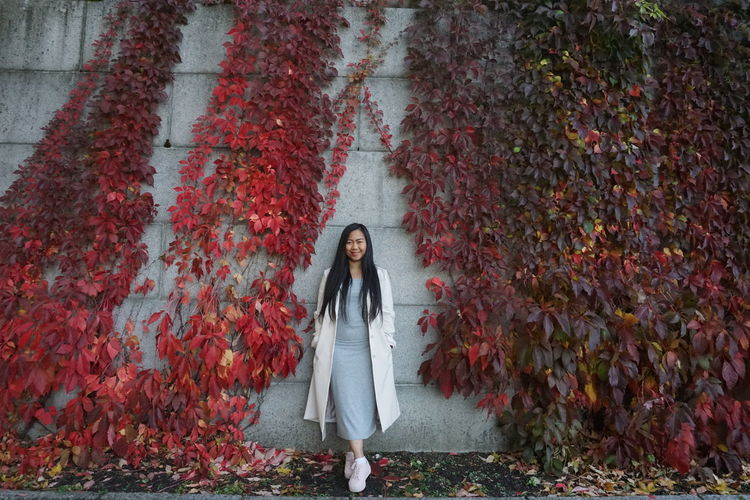 Autumn mood color changing Autumn Mood Autumn Autumn colors people and places Young Adult One Person Standing Full Length Leaf Plant Part Day Young Women Nature Portrait Hair Fashion Women Beautiful Woman Hairstyle Outdoors Adult Front View Wall Nice Atmosphere Nice Photo