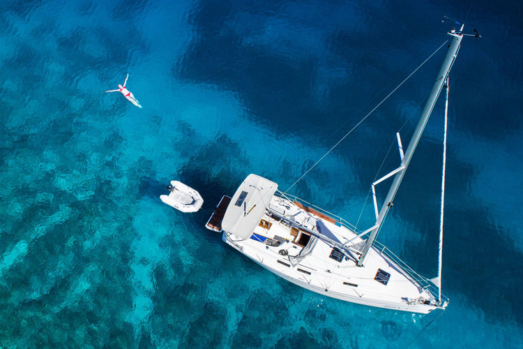 High angle view of boat on sea during sunny day