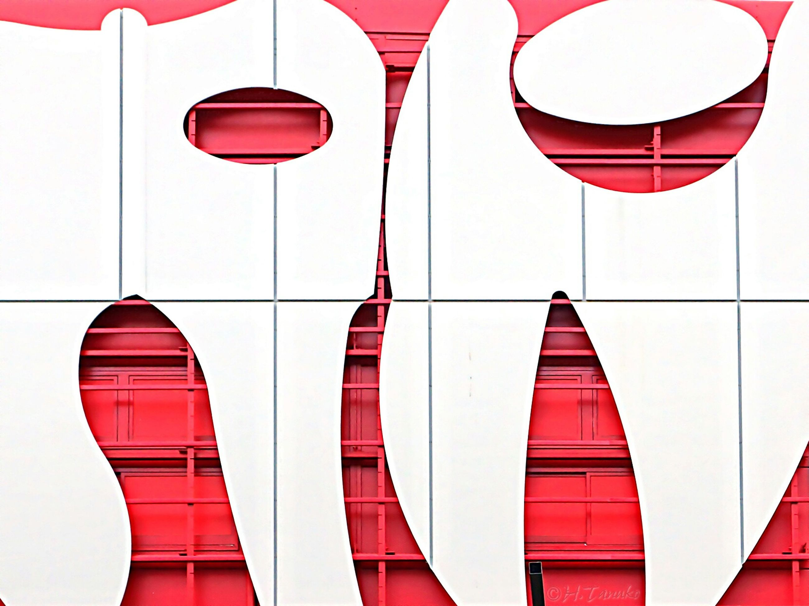 red, in a row, multi colored, built structure, architecture, striped, pattern, low angle view, national flag, white color, patriotism, repetition, shape, flag, hanging, geometric shape, indoors, identity, building exterior, design