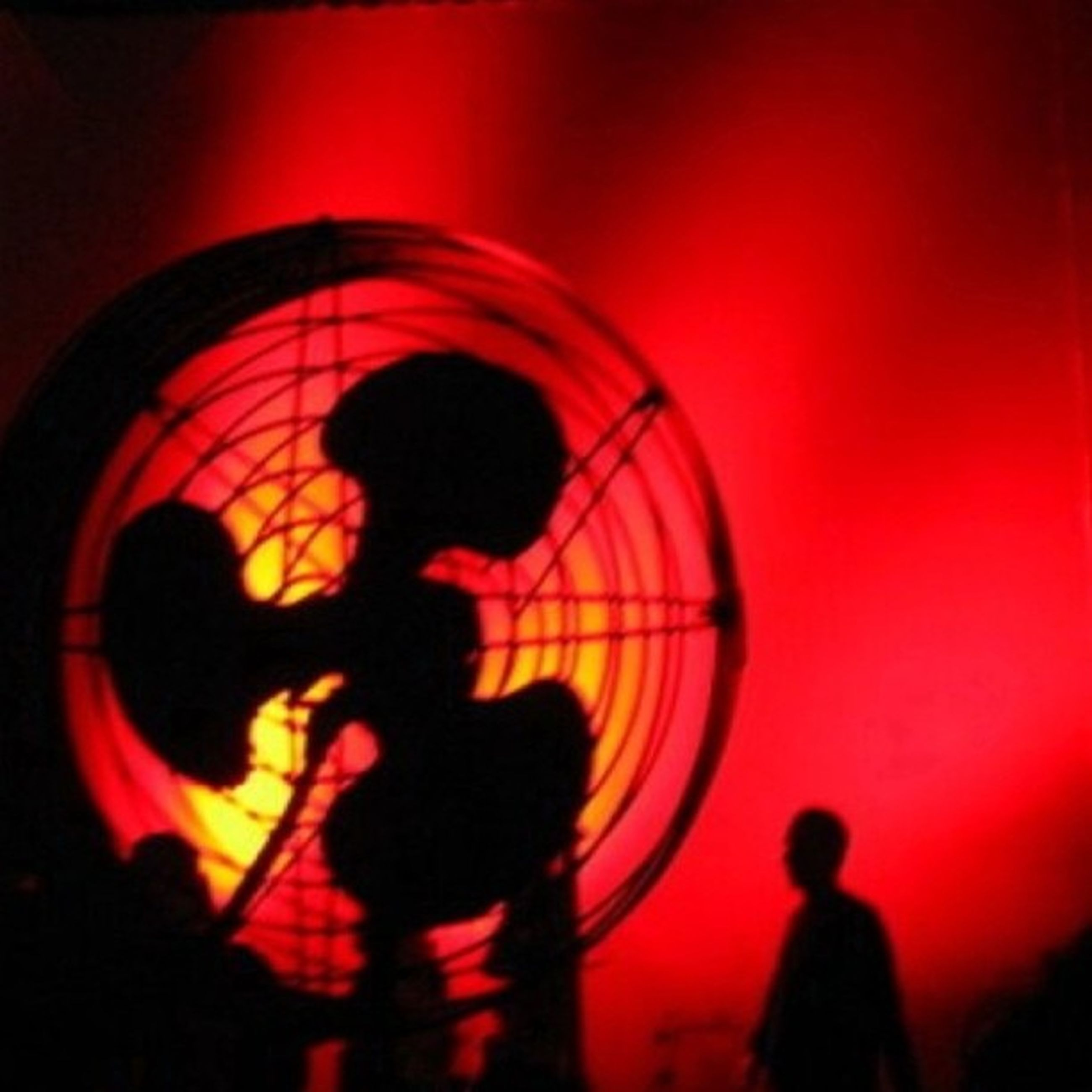 leisure activity, lifestyles, men, arts culture and entertainment, silhouette, illuminated, person, red, enjoyment, fun, standing, orange color, circle, night, rear view, sunset, unrecognizable person, playing