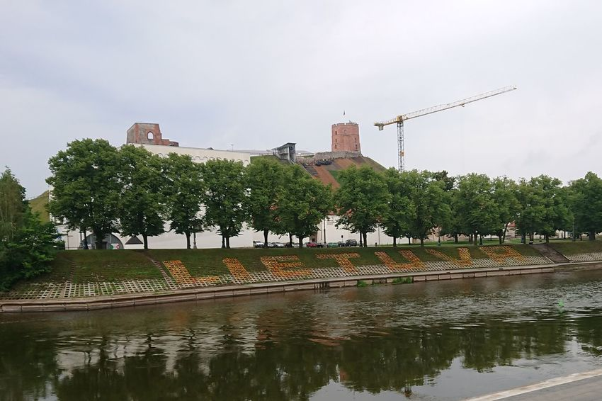 Lietuva Vilnius Neris River Gediminas Tower Crane - Construction Machinery Construction City Tree Water Business Finance And Industry Sky Architecture Building Exterior