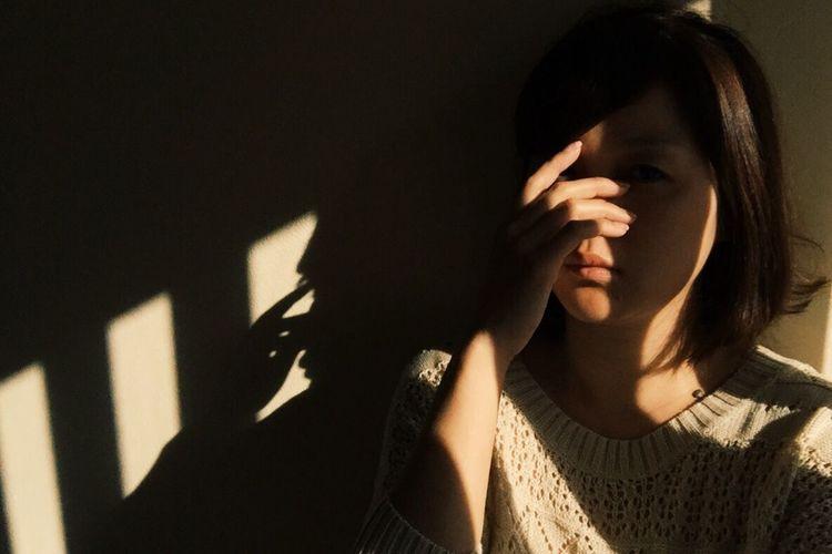 Portrait Of Upset Girl At Home In Darkroom
