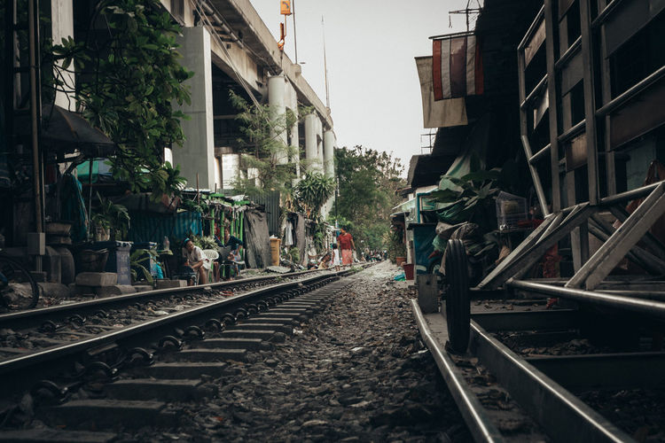 The Street Photographer - 2018 EyeEm Awards Architecture Building Building Exterior Built Structure City Day Diminishing Perspective Direction Incidental People Metal Mode Of Transportation Nature Outdoors Public Transportation Rail Transportation Railroad Track Sky Surface Level The Way Forward Track Transportation