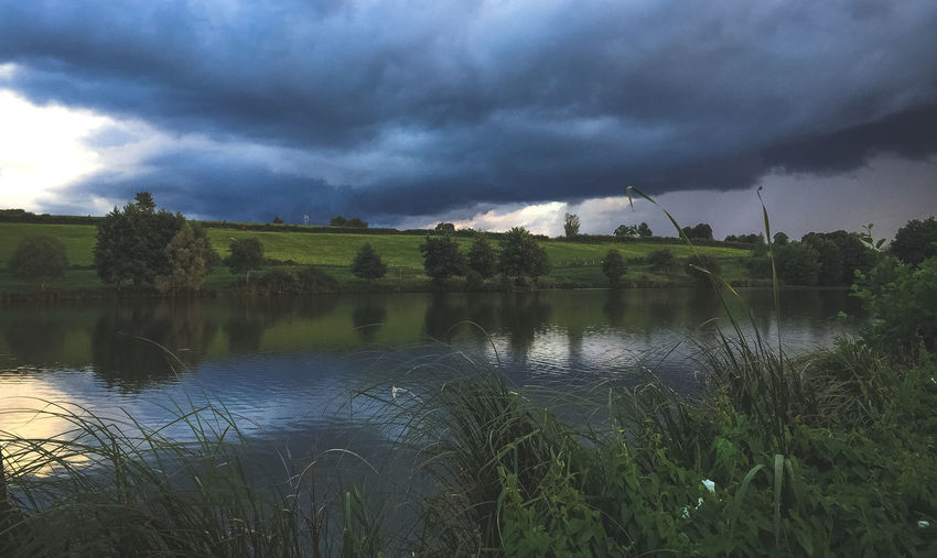 French landscape Beauty In Nature Cloud - Sky Day Environment Grass Growth Lake Nature No People Outdoors Overcast Plant Scenics - Nature Sky Storm Tranquil Scene Tranquility Water