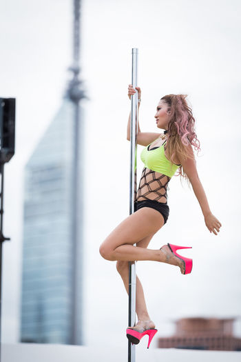 Built Structure City Day Full Length Happiness Lifestyles Motion One Woman Only One Young Woman Only Only Women People Poledance Poledancer Women Young Women