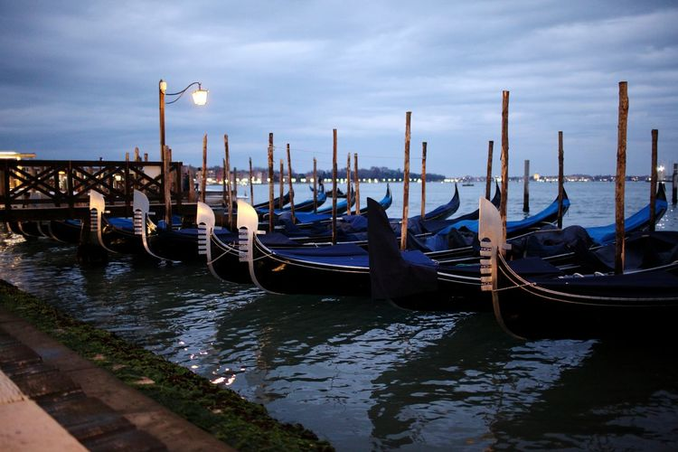 Gondola - Traditional Boat Cultures Travel Tourism Morning Travel Destinations Street Light Water Nautical Vessel Dramatic Sky Commercial Dock Cloud - Sky Sea Night Illuminated No People Outdoors
