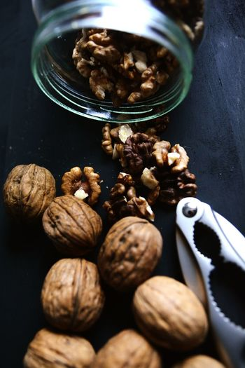 Close-up of walnuts and nutcracker on table