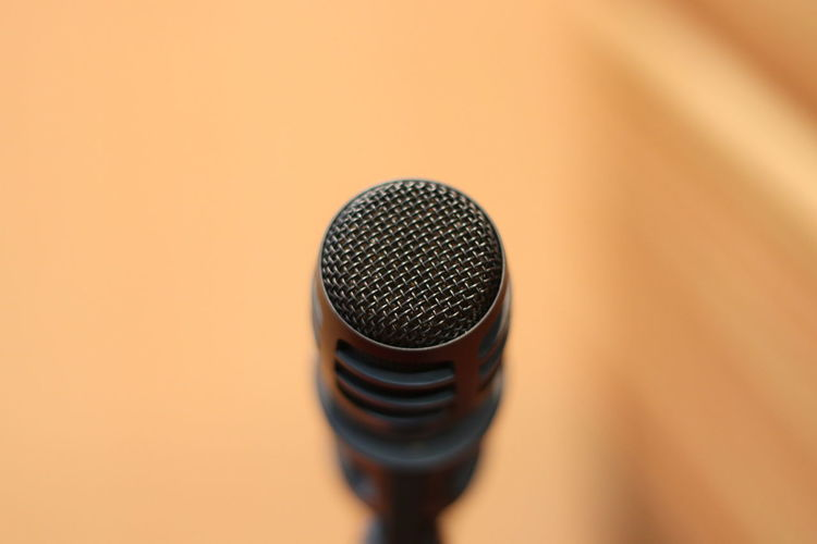 microphone Arts Culture And Entertainment Audio Equipment Close-up Colored Background Communication Copy Space Electrical Equipment Equipment Indoors  Input Device Microphone Music Musical Equipment No People Noise Performance Selective Focus Silver Colored Single Object Sound Recording Equipment Speech Stage Studio Shot Technology