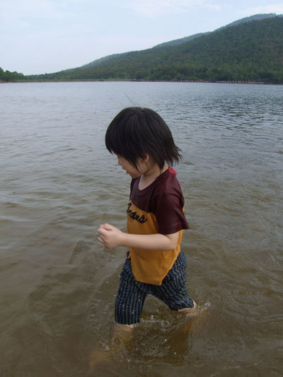 Happy summer Water One Person Real People Leisure Activity Lake Lifestyles Nature Beauty In Nature Casual Clothing Day Mountain Waterfront Child Outdoors Innocence Boy Running On Lake FUNNING  Happy Travel Summer Landscape Sky Vacation