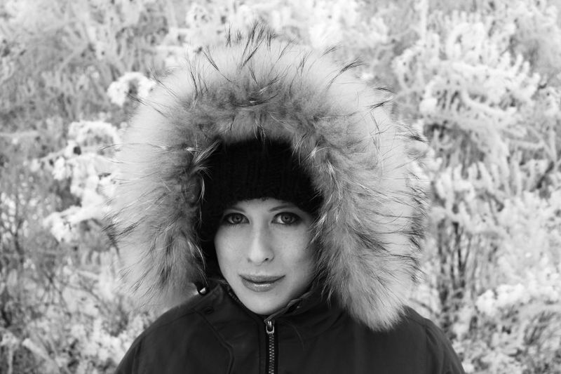 Close-Up Portrait Of Smiling Woman Wearing Warm Clothing During Winter