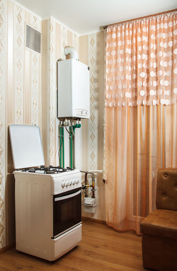 Stove and electric heater at home