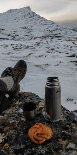 coffee breaking hiker feet with mountain view Coffee Break Coffee Time Frozen Nature Hiker Man Bun Pastry Pastries Thermos Water Beach Sea Landscape Snowcapped Snowcapped Mountain Snow Winter Cold Temperature Frozen Deep Snow Snowfall Cold Rocky Mountains Zermatt Verbier Ski Track Snow Covered Buoy Geology