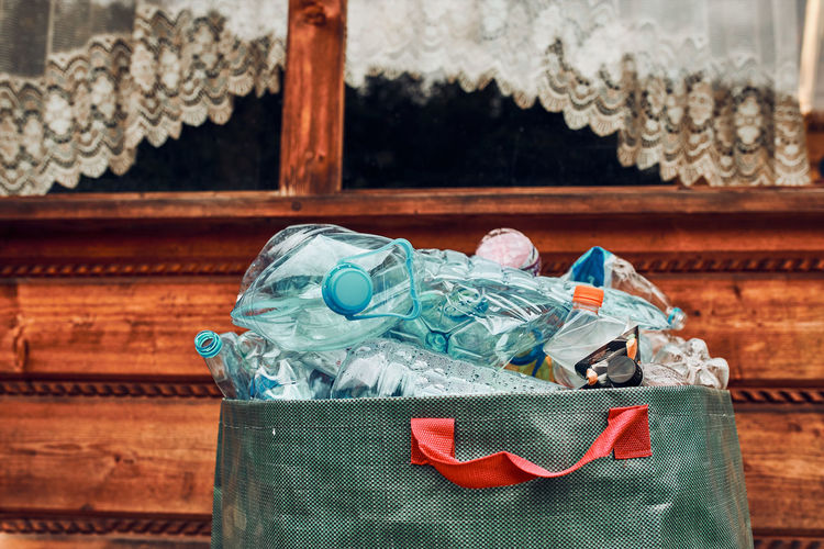 Plastic bottles collected in big container. heap of plastic bottles, cups, bags collected to recycle