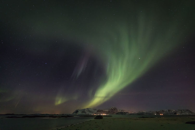 Astronomy Aurora Borealis Aurora Polaris Beach Beauty In Nature Cold Temperature Darkness And Light Illuminated Landscape Light Lofoten Luminosity Mountain Natural Phenomenon Nature The Great Outdoors - 2017 EyeEm Awards Night Northern Lights Norway Polar Climate Sea Snow Star - Space Water Winter