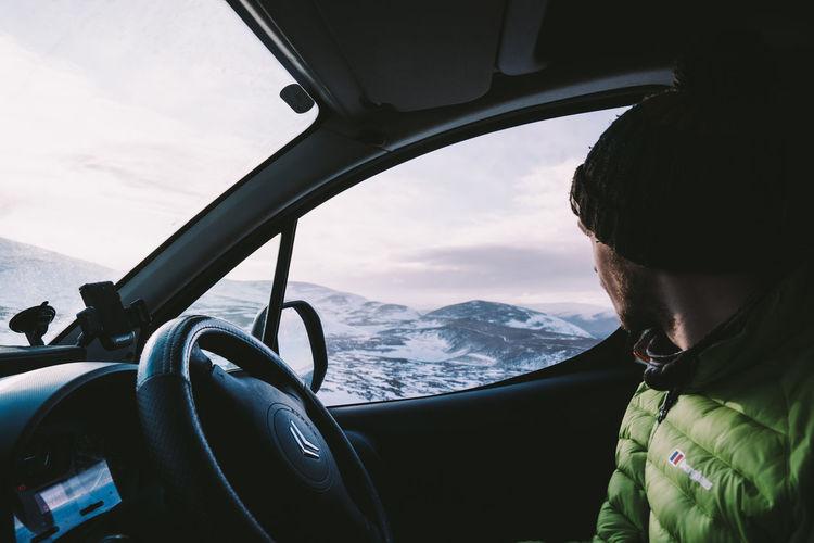Portrait of woman seen through car window
