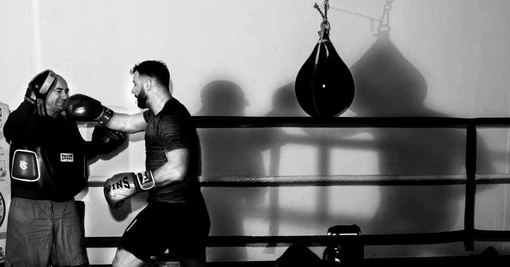 Blackandwhite Boxing - Sport Boxing Glove Boxing Ring Combat Sport Day Exercising Gym Health Club Indoors  Lifestyles Men Monochrome Motion One Person People Punching Real People Sport Sports Clothing Sports Training Sportsman Strength Young Adult Young Men