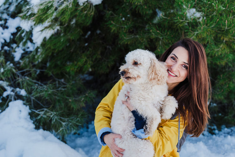 Young woman with dog in winter