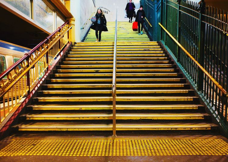 Steps Staircase Steps And Staircases Real People Railing Lifestyles Stairs Walking Women Men Leisure Activity The Way Forward Built Structure Indoors  Two People Hand Rail Technology Day Adult People Paint The Town Yellow