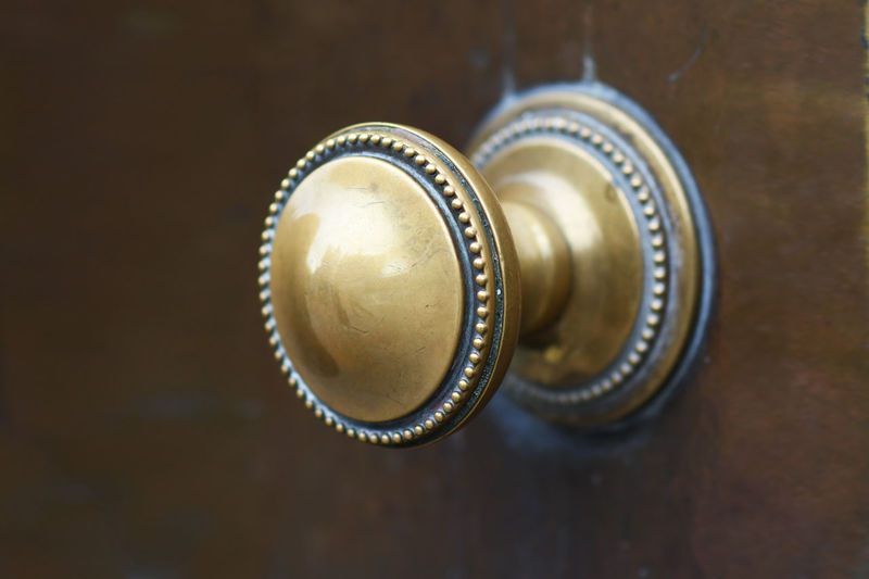 Close-up Still Life Table Focus On Foreground Gold Colored Brown Antique Shape Two Objects High Angle View Wood - Material Circle Geometric Shape Directly Above Knob Door Knob Brass Knob Brass Door Handle Door Victorian