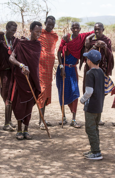 Small talk - Conversation with Maasai. My son striking a conversation with the Maasai men. This was on a visit to a village on the edge of the Ngorongoro Conservation Area. Africa Candid Candid Photography Candid Shot Conversation Conversations Culture Cultures East Africa Maasai Maasai People Maasai Village Medium Group Of People Ngorongoro Crater People Real People Standing Street Photography Tanzania Tradition Traditional Traditional Clothing Traditional Culture Tribe Tribes The Street Photographer - 2017 EyeEm Awards