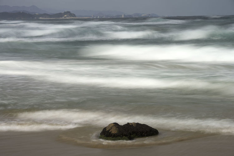 sea view of Hajodae Beach, Yangyang, Gangwondo, South Korea Beach Beauty In Nature Day Hajodae. Long Exposure Motion Nature No People Outdoors Sand Scenics Sea Sky Surge Tranquil Scene Tranquility Water Wave Wave Winter