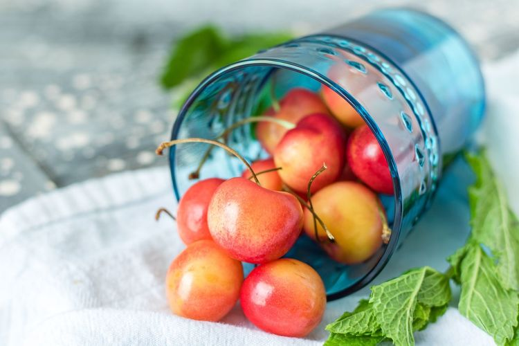 Close-up of cherries in container on table