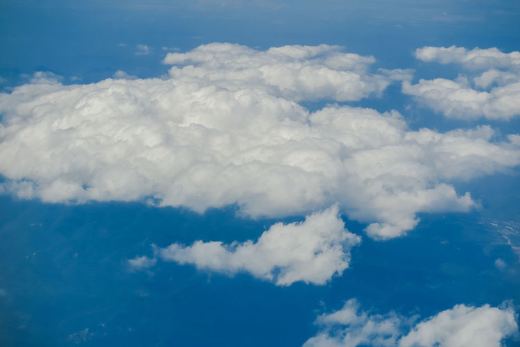 clear blue sky background with white clouds from above Cloud - Sky Beauty In Nature Scenics - Nature Tranquility Sky Tranquil Scene Cloudscape No People Idyllic Nature Day White Color Outdoors Backgrounds Fluffy Meteorology Blue Low Angle View Full Frame Softness